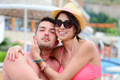 Happy young couple cuddling happy with love on the beach. Happy young couple on summer vacation smiling and hugging Stock Images