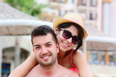 Happy young couple cuddling happy with love on the beach. Happy young couple on summer vacation smiling and hugging Royalty Free Stock Photo