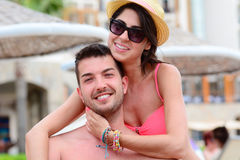 Happy young couple cuddling happy with love on the beach. Happy young couple on summer vacation smiling and hugging Stock Image