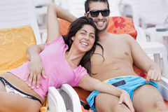 Happy young couple cuddling happy with love on the beach. Happy young couple on summer vacation smiling and hugging Stock Photo