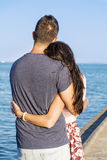 Happy young couple cuddling happy with love on a sea beach Stock Image