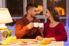 The  happy young couple with cups of tea Royalty Free Stock Photo