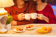 The  happy young couple with cups of tea Royalty Free Stock Photography