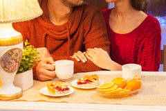 The  happy young couple with cups of tea Royalty Free Stock Images