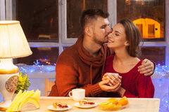 The  happy young couple with cups of tea Stock Photo