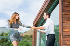 Happy young couple dancing at balcony in resort Royalty Free Stock Photo