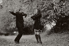 Happy young couple having fun. Happy young couple dancing  in garden, black and white Royalty Free Stock Images