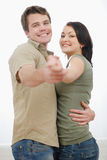 Happy young couple dancing at home Royalty Free Stock Photos