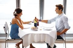 Happy young couple on date in restaurant Royalty Free Stock Photography