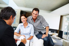 Happy young couple discussing investment plans Stock Photography