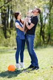 Happy young couple and  dog Royalty Free Stock Photos