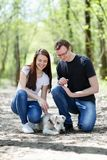 Happy young couple and  dog Royalty Free Stock Photo