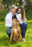 Happy Young Couple with Dog Royalty Free Stock Photo