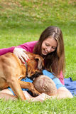 Happy Young Couple with Dog Stock Photography
