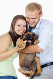 Happy Young Couple with a Dog. Stock Photography