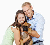 Happy Young Couple with a Dog. Royalty Free Stock Photography