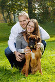 Happy young couple with dog Stock Photos