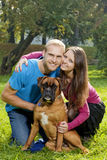 Happy Young Couple with Dog Stock Image