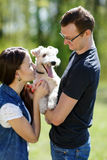 Happy young couple and  dog. Happy young couple and their dog at the park Stock Photo