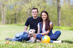 Happy young couple and  dog Stock Images