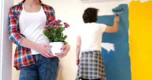 Happy young couple doing home renovations royalty free stock photo