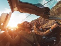 Free Happy Young Couple Doing Road Trip In Tropical City - Travel People Having Fun Driving In Trendy Convertible Car Stock Photography - 187740782