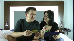 Happy young couple doing shopping on internet in the tablet device stock video footage