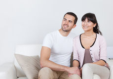 Happy young couple dreaming about the future. At home Royalty Free Stock Photography