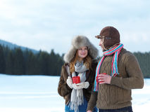 Happy young couple drink warm tea at winter Royalty Free Stock Images