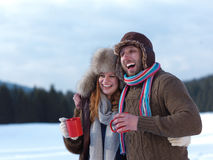 Happy young couple drink warm tea at winter Royalty Free Stock Photos