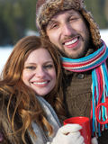 Happy young couple drink warm tea at winter Stock Photography