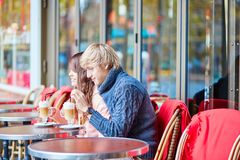Happy young couple drinking coffee in cafe Stock Images