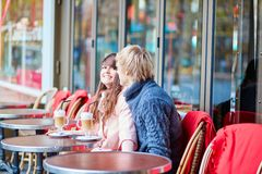 Happy young couple drinking coffee in cafe Royalty Free Stock Photo