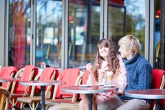 Happy young couple drinking coffee in cafe Royalty Free Stock Images