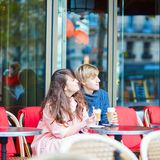 Happy young couple drinking coffee in cafe Royalty Free Stock Photos
