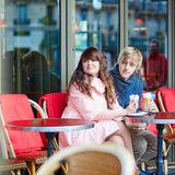 Happy young couple drinking coffee in cafe Stock Photos