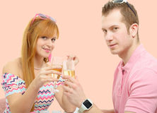 Happy young couple drinking glass of champagne Stock Images