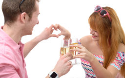 Happy young couple drinking glass of champagne Royalty Free Stock Image