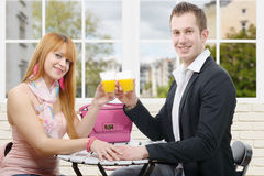 Happy young couple drinking orange juice Royalty Free Stock Photos