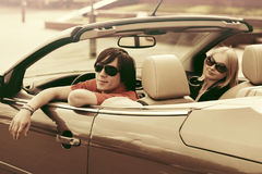 Happy young couple driving convertible car Royalty Free Stock Photo
