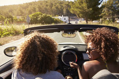 Happy young couple driving in an open top car, Ibiza, Spain Stock Image