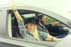 Happy young couple driving on the road Stock Image
