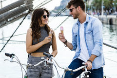 Happy young couple eating ice cream in the street. Royalty Free Stock Photos