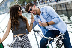 Happy young couple eating ice cream in the street. Royalty Free Stock Images