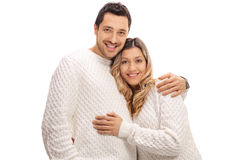 Happy young couple in an embrace. Isolated on white background Stock Images