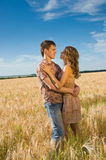 Loving couple on wheat field Royalty Free Stock Photography
