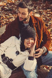 Happy young couple in embrace. In the park Royalty Free Stock Photo