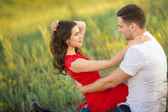 Happy young couple embrace in park Royalty Free Stock Photography