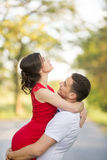 Happy young couple embrace in park. Beautiful Young Couple Have Romantic Dating in Park. Happy Man and Woman Outdoor. Relationships Royalty Free Stock Images