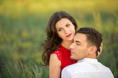 Happy young couple embrace in park. Portrait of Beautiful Young Couple Have Romantic Dating in Park. Happy Man and Woman Fall in Love Outdoor. Relationships Stock Photos